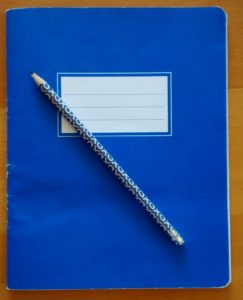 Notebook and pencil for planning schedules