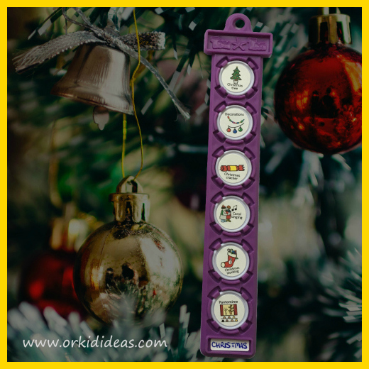 Purple TomTag on christmas tree showing symbol images of Christmas traditions