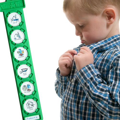 boy buttoning shirt with TomTag checklist