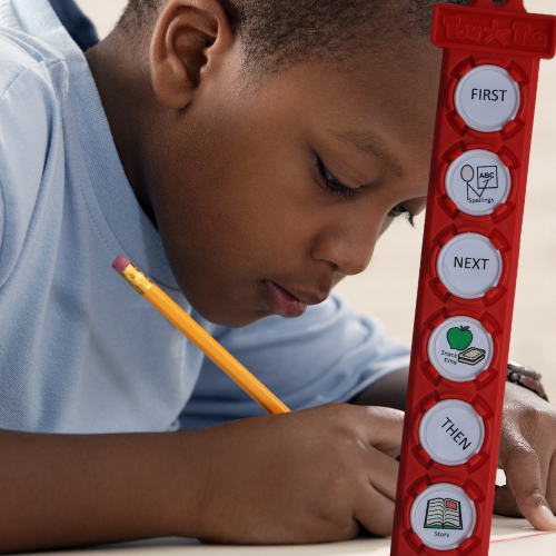 boy writing with tomtag checklist