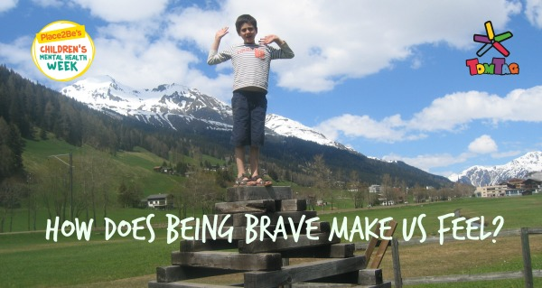 boy stood on stacked logs with text how does brave make you feel
