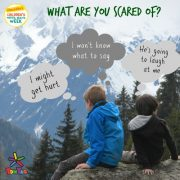 background of mountains, 2 children sitting with thought bubbles to show what they are afraid of