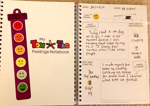 TomTag feelings notebook with example page filled in