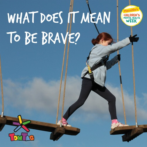girl on high ropes stepping onto a plank