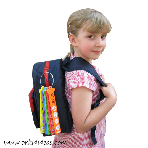 school girl carrying rucksack with packing checklist attached
